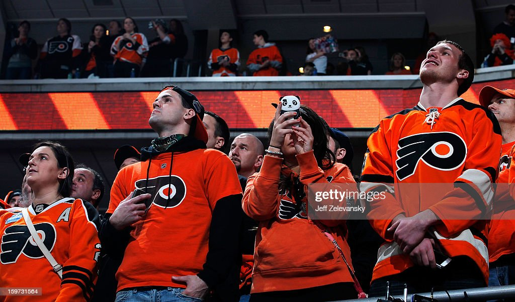 Fans of the Philadelphia Flyers watch as the team takes the ice in the season opener against the Pittsburgh Penguins at Wells Fargo Center on January 19, 2013 in Philadelphia, Pennsylvania.