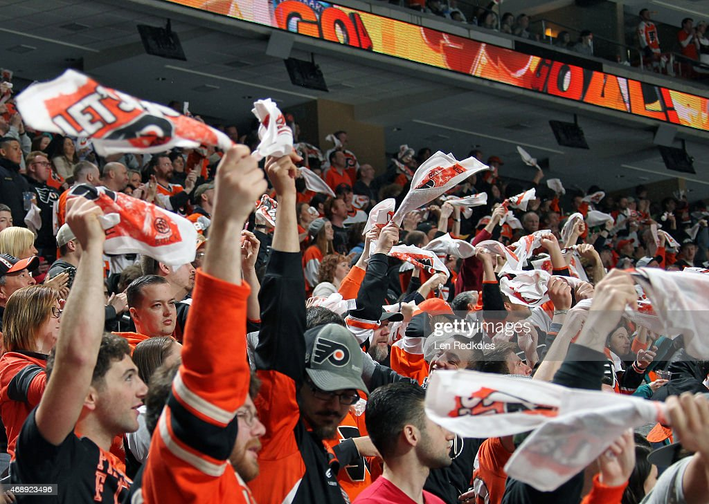 Fans of the Philadelphia Flyers wave rally towels during a game against the Pittsburgh Penguins on April 5 2015 at the Wells Fargo Center in...