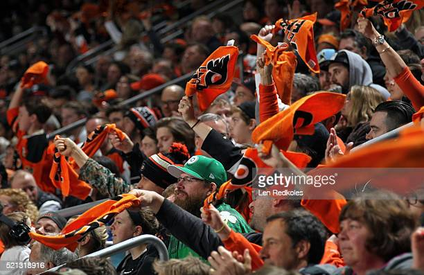 Fans of the Philadelphia Flyers wave their orange rally towels against the Toronto Maple Leafs on April 7 2016 at the Wells Fargo Center in...