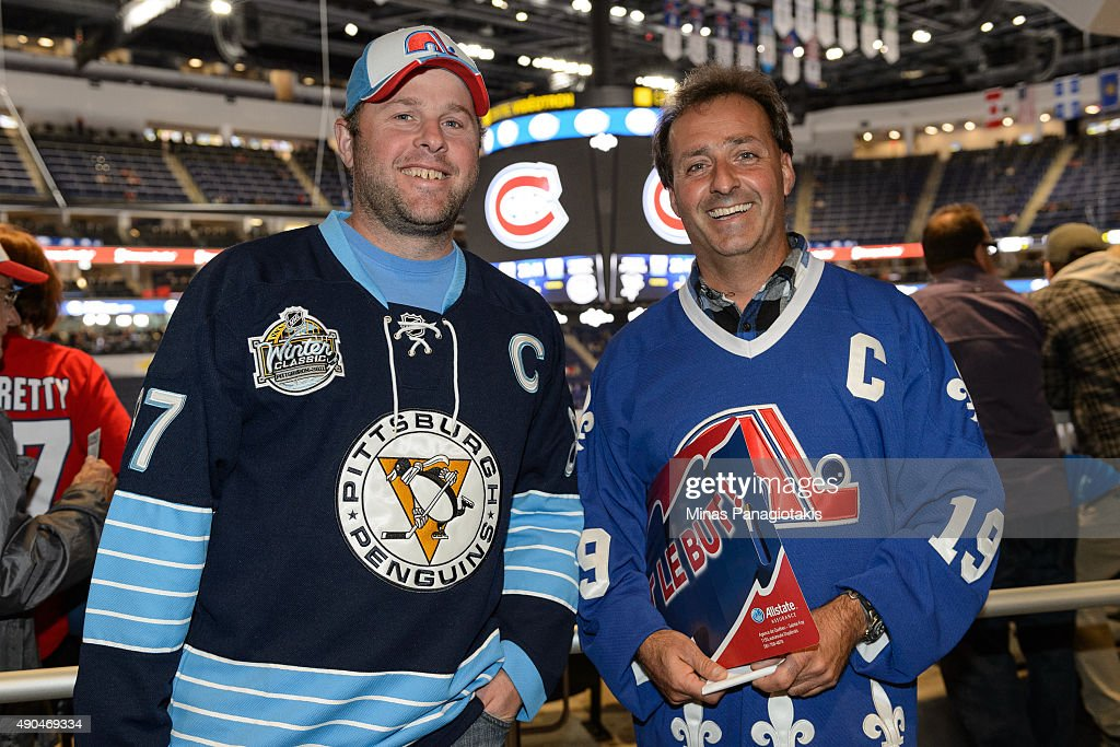 Fans of the Pittsburgh Penguins and Quebec Nordiques enjoy the atmosphere during the NHL pre-season game between the Montreal Canadiens and the Pittsburgh Penguins at the Videotron Centre on September 28, 2015 in Quebec City, Quebec, Canada. The Montreal Canadiens defeated the Pittsburgh Penguins 4-1.