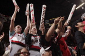 Fans of the Portland Trail Blazers celebrate during a game against the Houston Rockets in Game Four of the Western Conference Quarterfinals during...