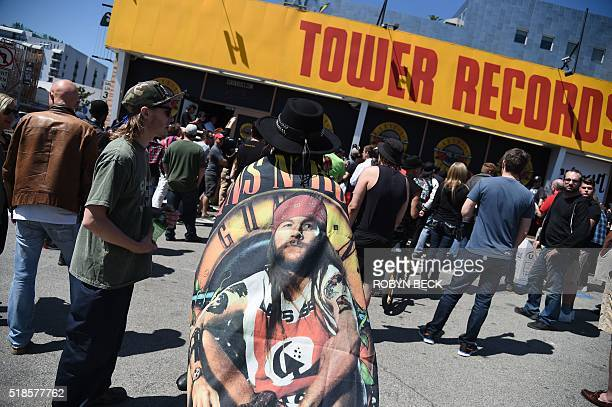 Fans of the rock band Guns N' Roses wait outside the Tower Records building on the Sunset Strip trying to buy a ticket for an impromptu performance...