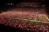 Fans of the Rutgers Scarlet Knights rush the field after their team defeated the Louisville Cardinals 2825 at Rutgers Stadium on November 9 2006 in...