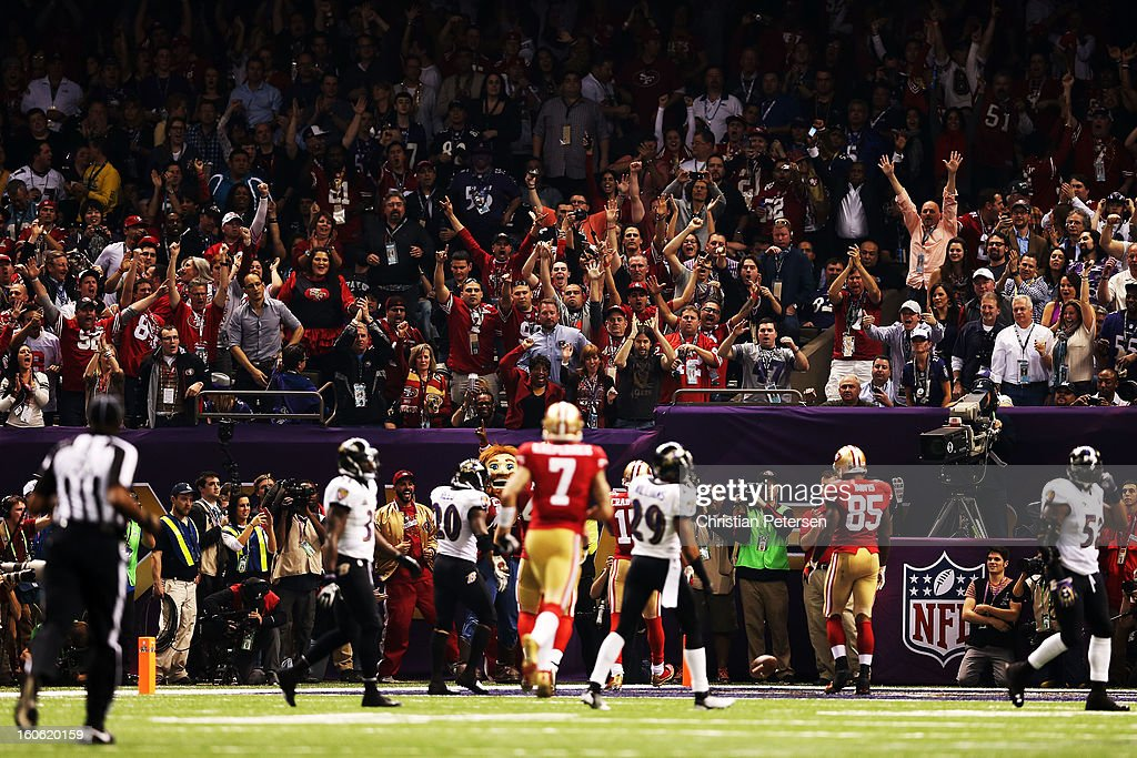 Fans of the San Francisco 49ers celebrates as Michael Crabtree #15 of the San Francisco 49ers scores scores a touchdown in the third quarter against the Baltimore Ravens during Super Bowl XLVII at the Mercedes-Benz Superdome on February 3, 2013 in New Orleans, Louisiana.