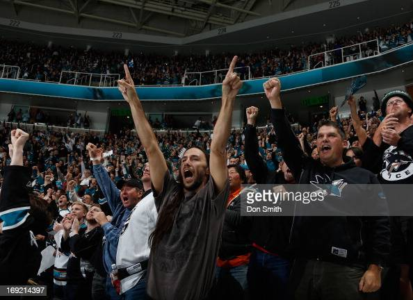 Fans of the San Jose Sharks celebrate a goal against the Los Angeles Kings in Game Four of the Western Conference Semifinals during the 2013 Stanley...