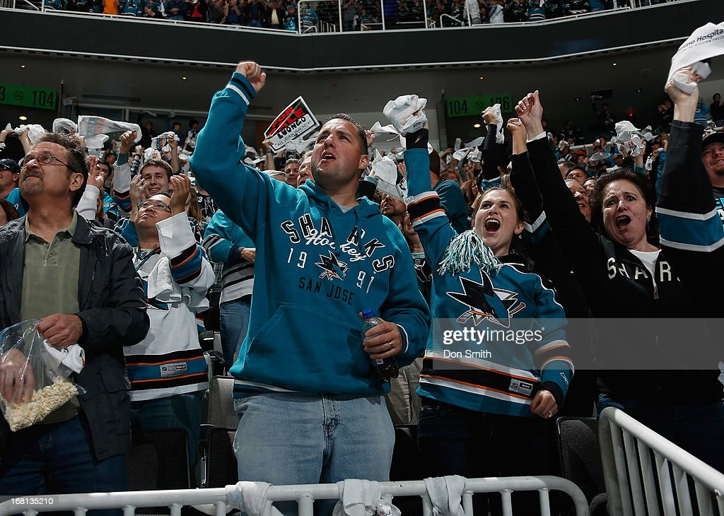 Fans of the San Jose Sharks celebrate a goal against the Vancouver Canucks in Game One of the Western Conference Quarterfinals during the 2013 Stanley Cup Playoffs at HP Pavilion on May 5, 2013 in San Jose, California.