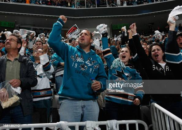 Fans of the San Jose Sharks celebrate a goal against the Vancouver Canucks in Game One of the Western Conference Quarterfinals during the 2013...