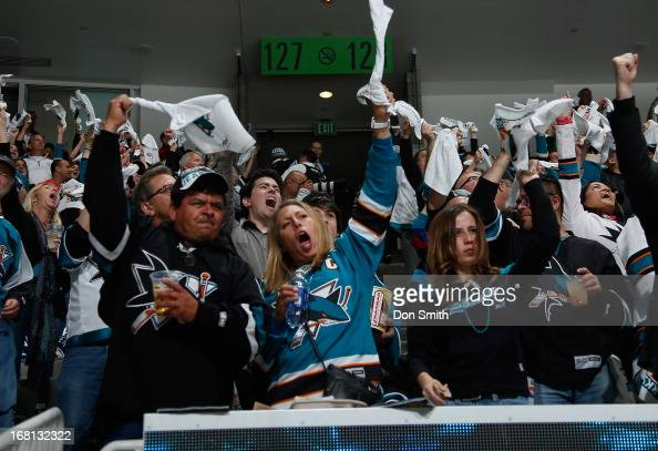 Fans of the San Jose Sharks celebrate goal against the Vancouver Canucks in Game One of the Western Conference Quarterfinals during the 2013 Stanley...