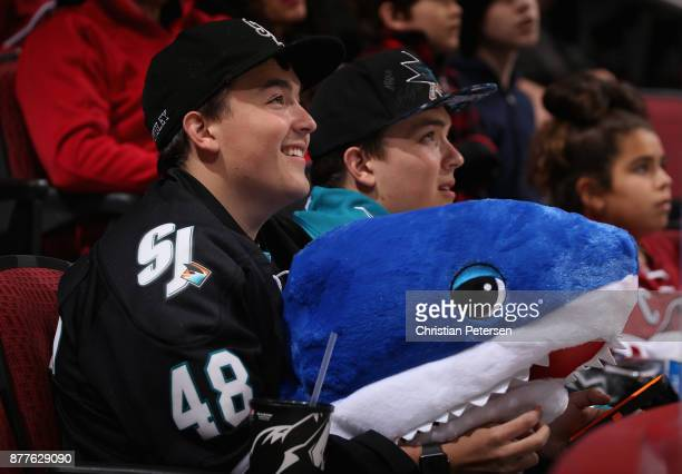 Fans of the San Jose Sharks look on during the second period of the NHL game against the Arizona Coyotes at Gila River Arena on November 22 2017 in...
