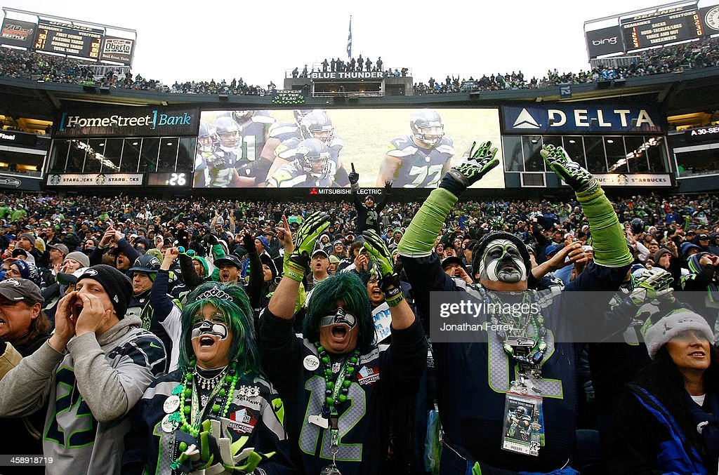 Fans of the Seattle Seahawks cheer against the Arizona Cardinals on December 22, 2013 at CenturyLink Field in Seattle, Washington.