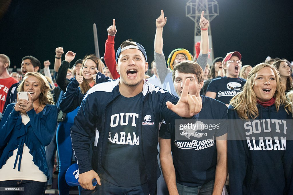 Fans of the South Alabama Jaguars cheer for their team during their game against the Arkansas State Red Wolves on November 2, 2013 at Ladd-Peebles Stadium in Mobile, Alabama. Arkansas State defeated South Alabama 17-16.