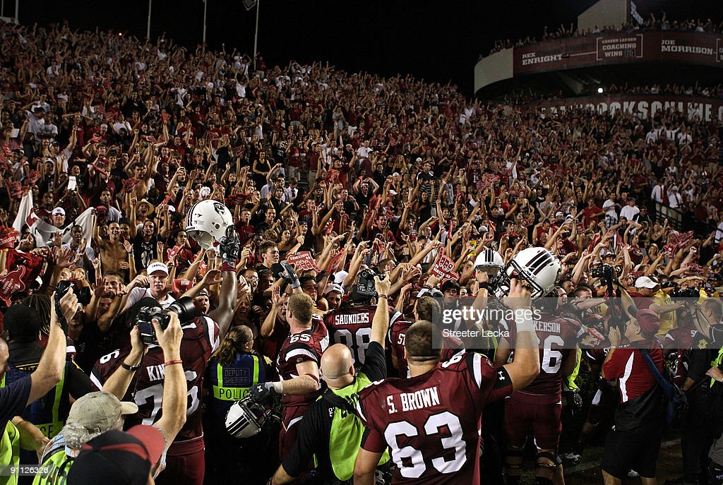 Fans of the South Carolina Gamecocks celebrate after a 16-10 victory over the Ole Miss Rebels after their game at Williams-Brice Stadium on September 24, 2009 in Columbia, South Carolina.