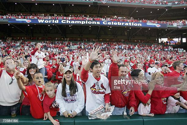 Fans of the St Louis Cardinals cheer as the players take the field during the World Series Victory Parade and Rally on October 29 2006 at Busch...