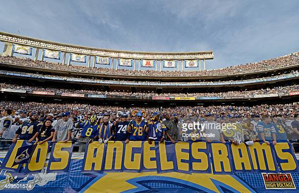 Fans of the St Louis Rams hold a 'Los Angeles Rams' sign against the San Diego Chargers during their NFL Game on November 23 2014 in San Diego...