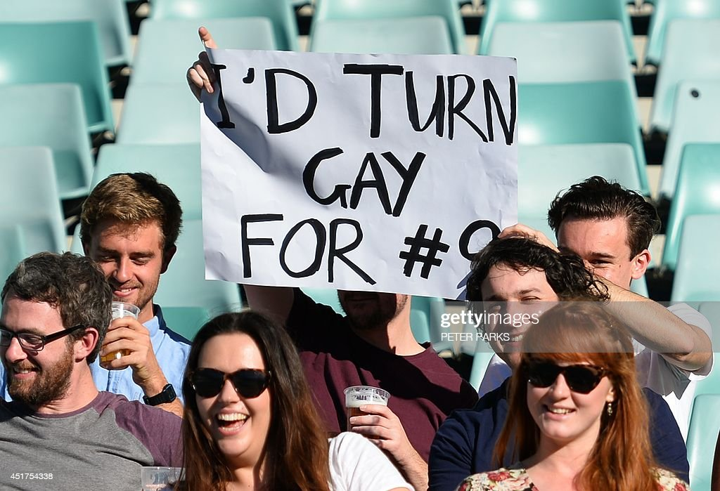 Fans of the Sydney Convicts, an all gay rugby team, cheer as they play against Macquarie University at the Allianz Stadium in Sydney on July 6, 2014. Australia's Sydney Convicts made history when they become the first gay rugby team in the world to play on the same bill as a professional match against Macquarie University in the curtain-raiser to the Super Rugby game between the New South Wales Waratahs and New Zealand's Otago Highlanders. AFP PHOTO / Peter PARKS -- IMAGE STRICTLY FOR EDITORIAL USE - STRICTLY NO COMMERCIAL USE