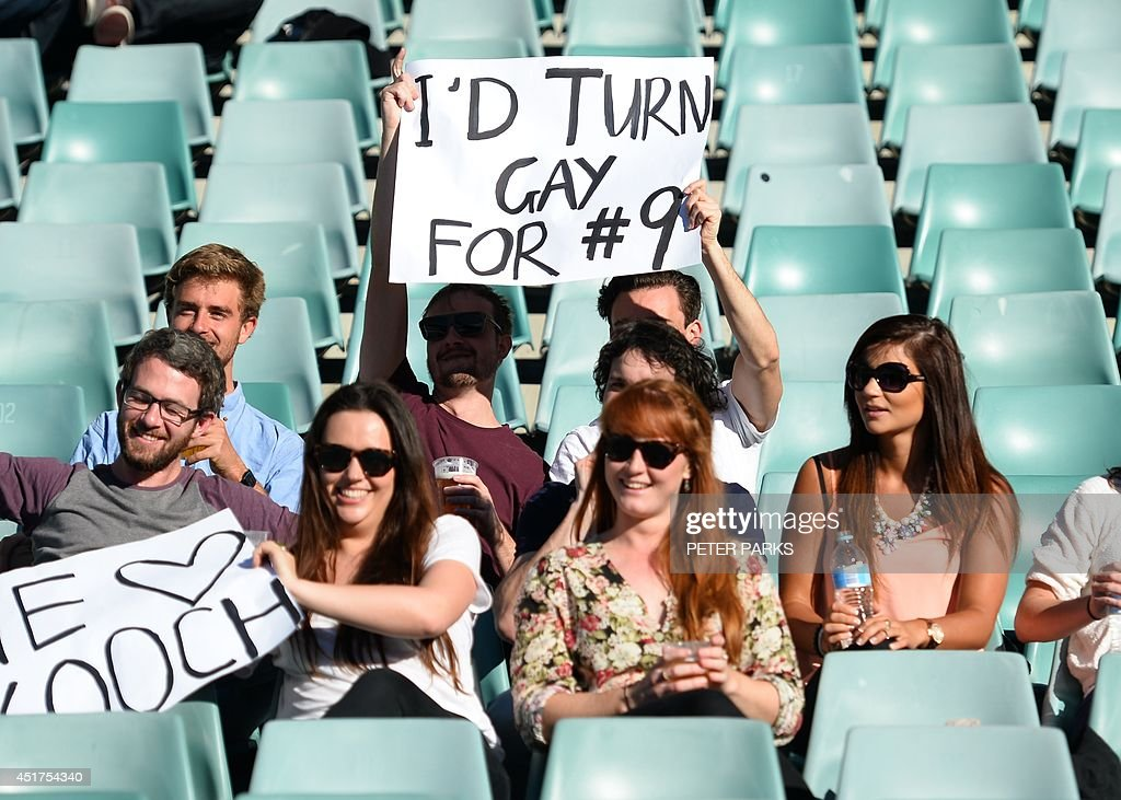 Fans of the Sydney Convicts, an all gay rugby team, cheer as they play against Macquarie University at the Allianz Stadium in Sydney on July 6, 2014. Australia's Sydney Convicts made history when they become the first gay rugby team in the world to play on the same bill as a professional match against Macquarie University in the curtain-raiser to the Super Rugby game between the New South Wales Waratahs and New Zealand's Otago Highlanders. AFP PHOTO / Peter PARKS -- IMAGE