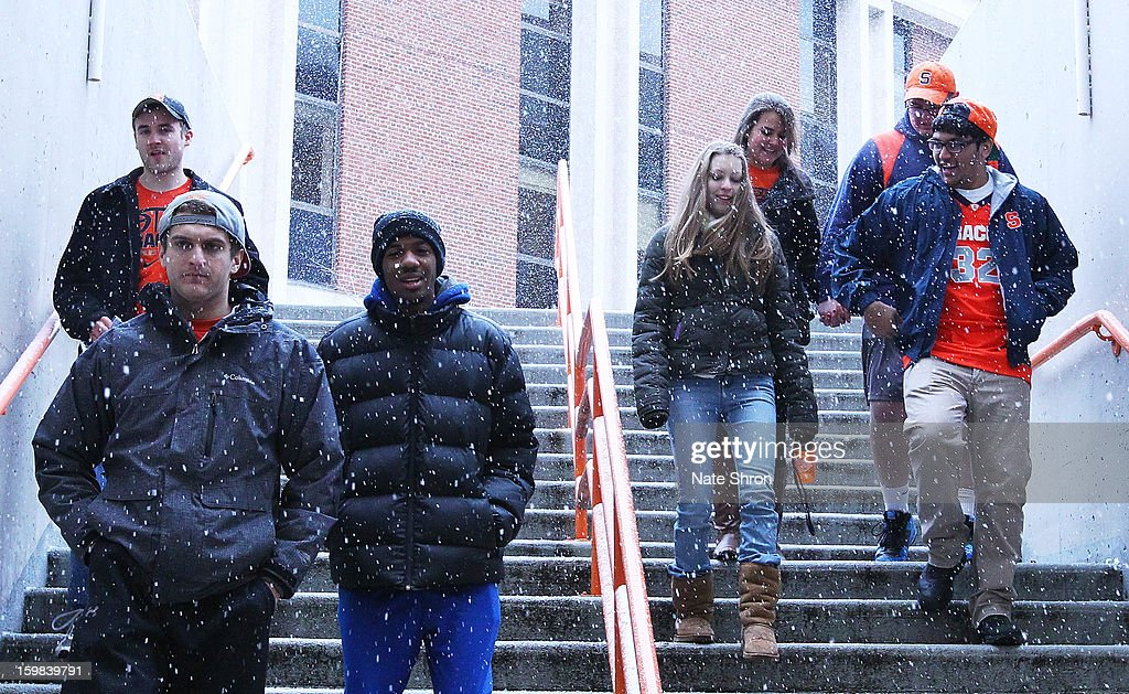 Fans of the Syracuse Orange arrive in the snow before the game against the Cincinnati Bearcats at the Carrier Dome on January 21, 2013 in Syracuse, New York.