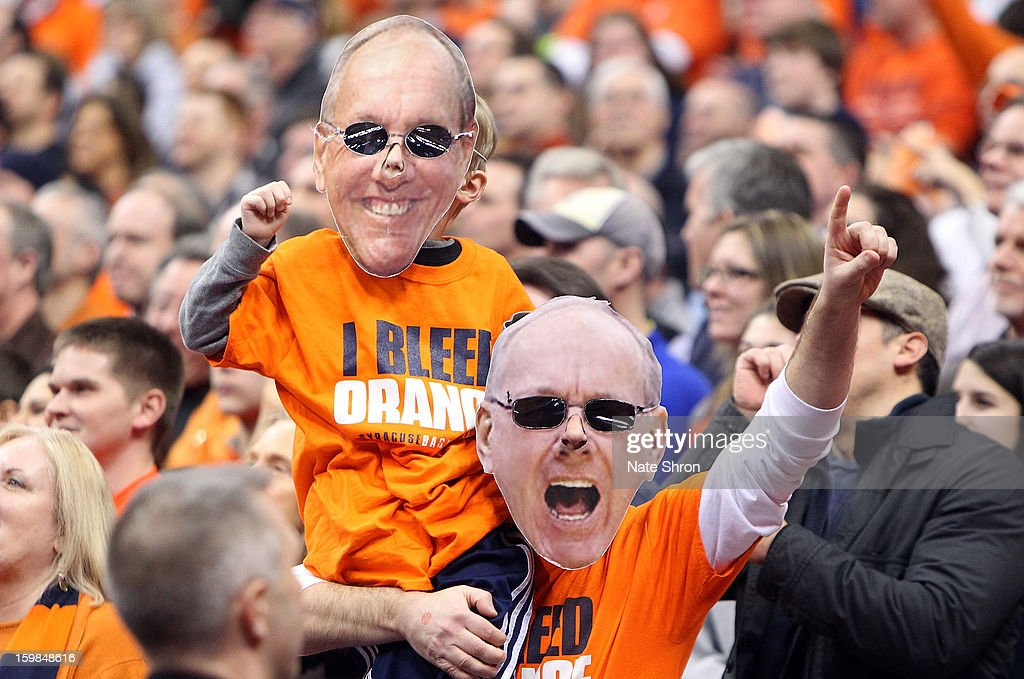 Fans of the Syracuse Orange cheer with masks of head coach Jim Boeheim (not pictured) over their faces during the game against the Cincinnati Bearcats at the Carrier Dome on January 21, 2013 in Syracuse, New York.