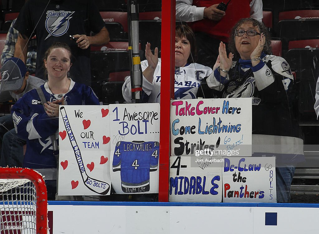 Fans of the Tampa Bay Lightning watch the team warm up prior to the game against the Florida Panthers at the BB&T Center on February 16, 2013 in Sunrise, Florida.