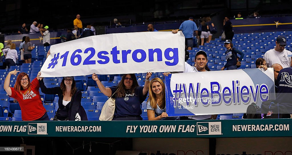 Fans of the Tampa Bay Rays celebrate the Rays walkoff victory over the Boston Red Sox at Tropicana Field on September 20, 2012 in St. Petersburg, Florida.