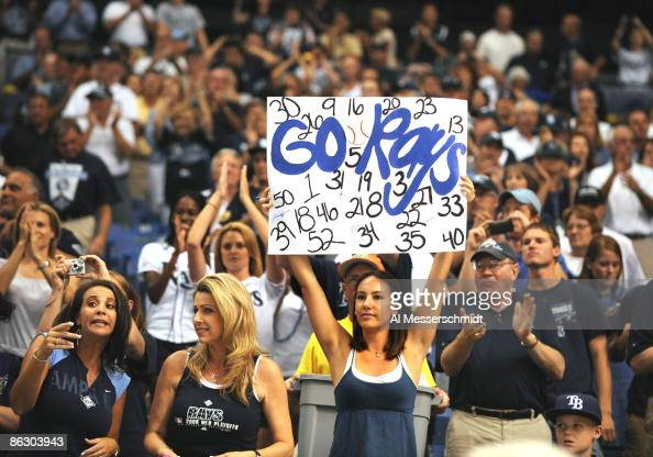 Fans of the Tampa Bay Rays cheer before play against the New York Yankees on April 13 2009 at Tropicana Field in St Petersburg Florida