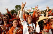 Fans of the Texas Longhorns cheer as the team arrives at the stadium before the start the BCS National Championship Rose Bowl Game between the...
