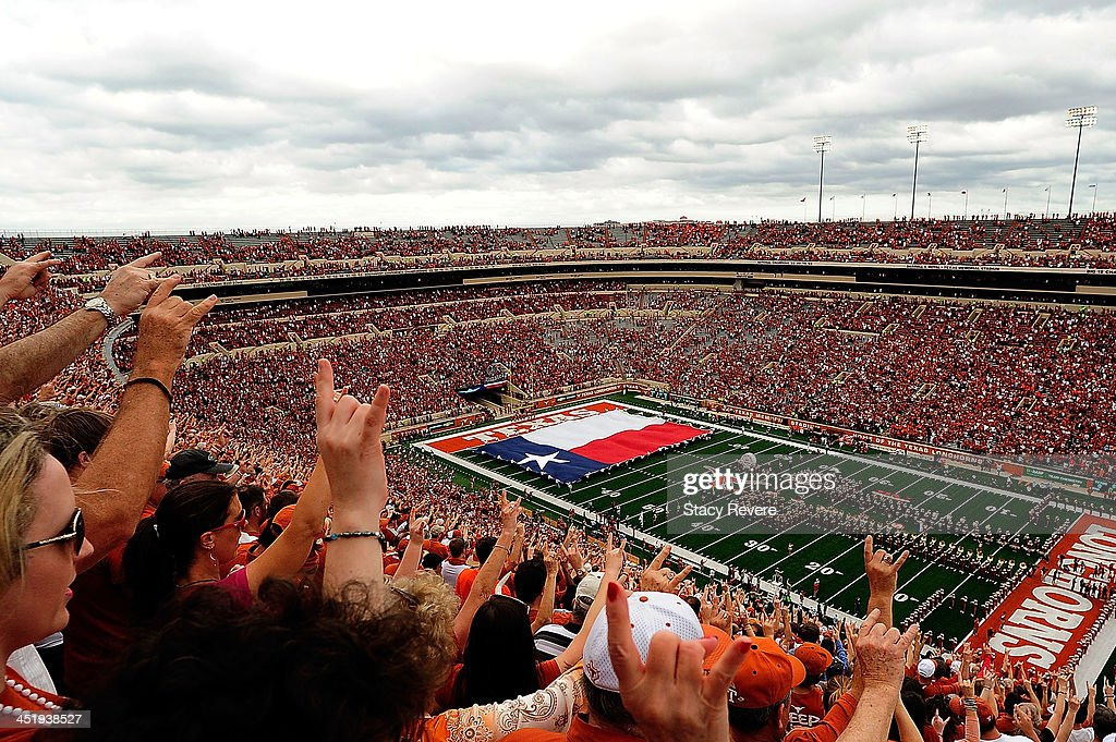 Fans of the Texas Longhorns cheer prior to a game against the Oklahoma State Cowboys at Darrell K RoyalTexas Memorial Stadium on November 16 2013 in...