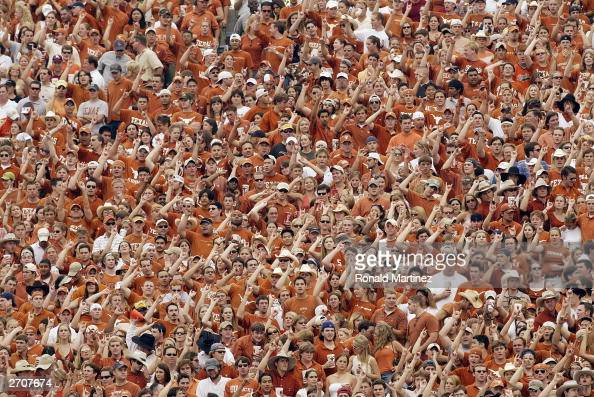 Fans of the Texas Longhorns show their support during the game against the Oklahoma Sooners at the Cotton Bowl on October 11 2003 in Dallas Texas The...