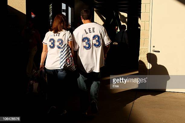 Fans of the Texas Rangers wearing autographed Cliff Lee jersey walk through the stadium against the San Francisco Giants in Game Five of the 2010 MLB...