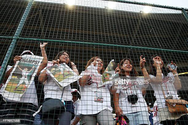 Fans of the Tokyo Japan team celebrate after defeating the West team from Chula Vista Ca 64 during the Little League World Series Championship game...