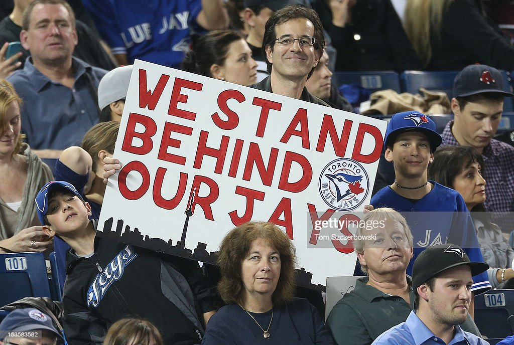 Fans of the Toronto Blue Jays hold a sign during MLB game action against the Minnesota Twins on October 3, 2012 at Rogers Centre in Toronto, Ontario, Canada.