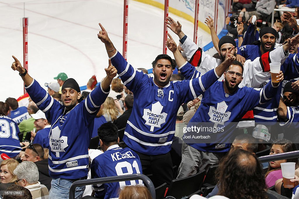 Fans of the Toronto Maple Leafs celebrate in the final minute of the game against the Florida Panthers at the BB&T Center on April 25, 2013 in Sunrise, Florida. The Maple Leafs defeated the Panthers 4-0.