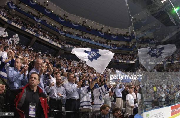 Fans of the Toronto Maple Leafs stand and applaud in appreciation during game six of the Eastern Conference finals against the Carolina Hurricanes at...