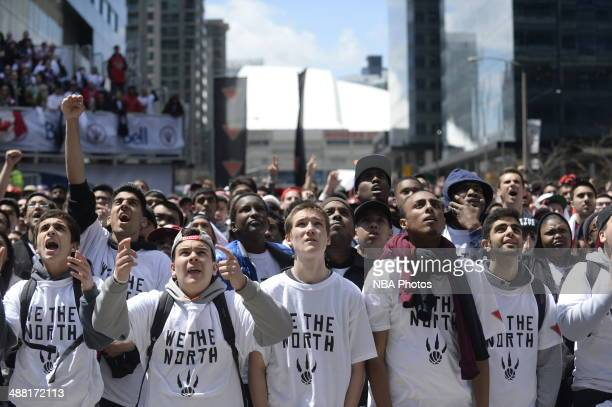 Fans of the Toronto Raptors watch the game during Game Seven of the Eastern Conference Quarterfinals during the NBA Playoffs at the Air Canada Centre...