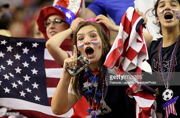 Fans of the United States celebrate after the USA 20 victory against Germany in the FIFA Women's World Cup 2015 SemiFinal Match at Olympic Stadium on...