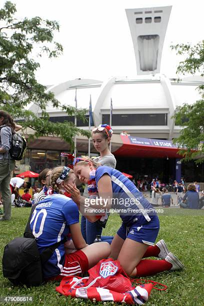 Fans of the United States paint their faces outside Olympic Stadium before the USA takes on Germany in the FIFA Women's World Cup 2015 SemiFinal...