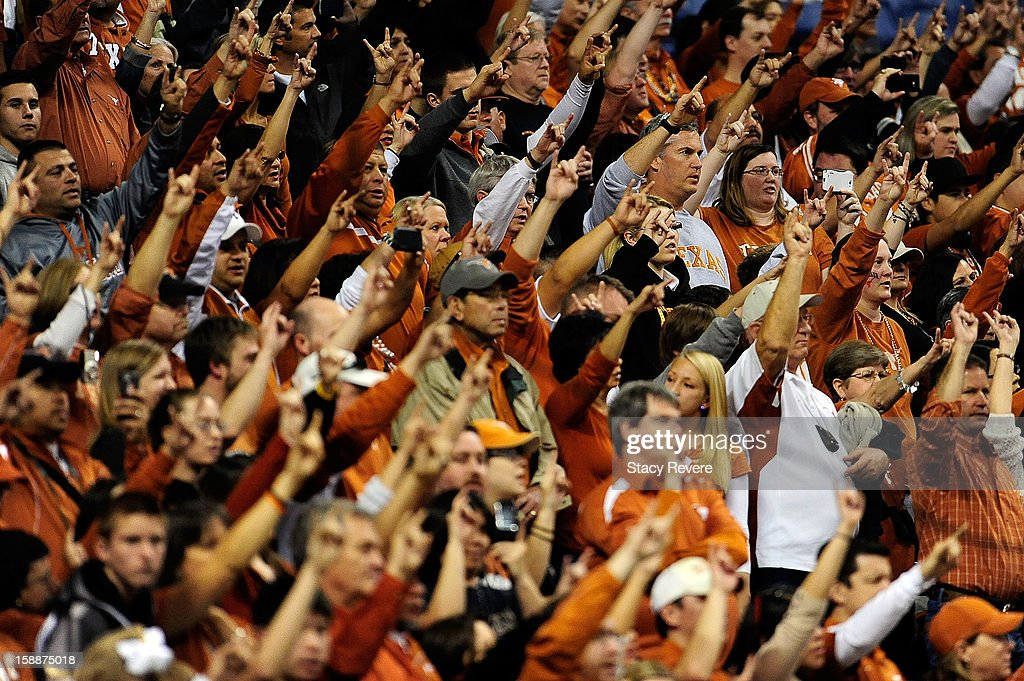 Fans of the University of Texas Longhorns cheer their team the during the Valero Alamo Bowl against the Oregon State Beavers at the Alamodome on...