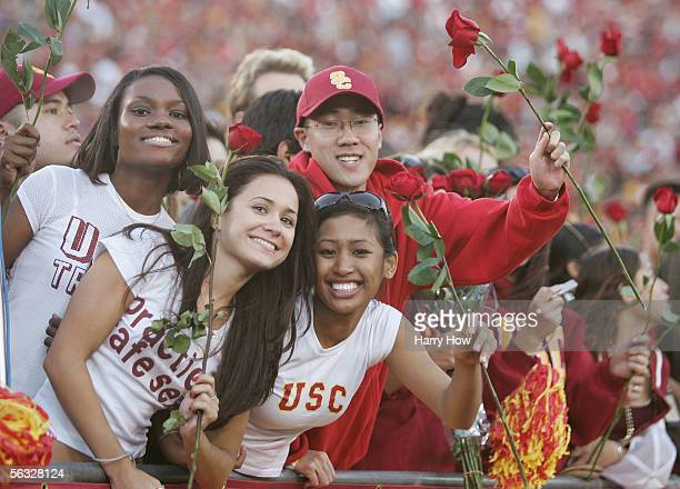 Fans of the USC Trojans hold up roses in hopes of a trip to the Rose Bowl against the UCLA Bruins December 3 2005 at the Los Angeles Memorial...