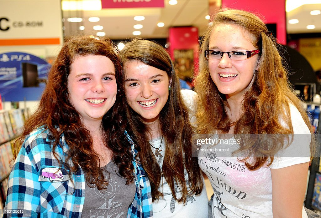 Fans of The Vamps have copies of their new single 'Can We Dance' signed at HMV Birmingham Bullring on October 4, 2013 in Birmingham, England.
