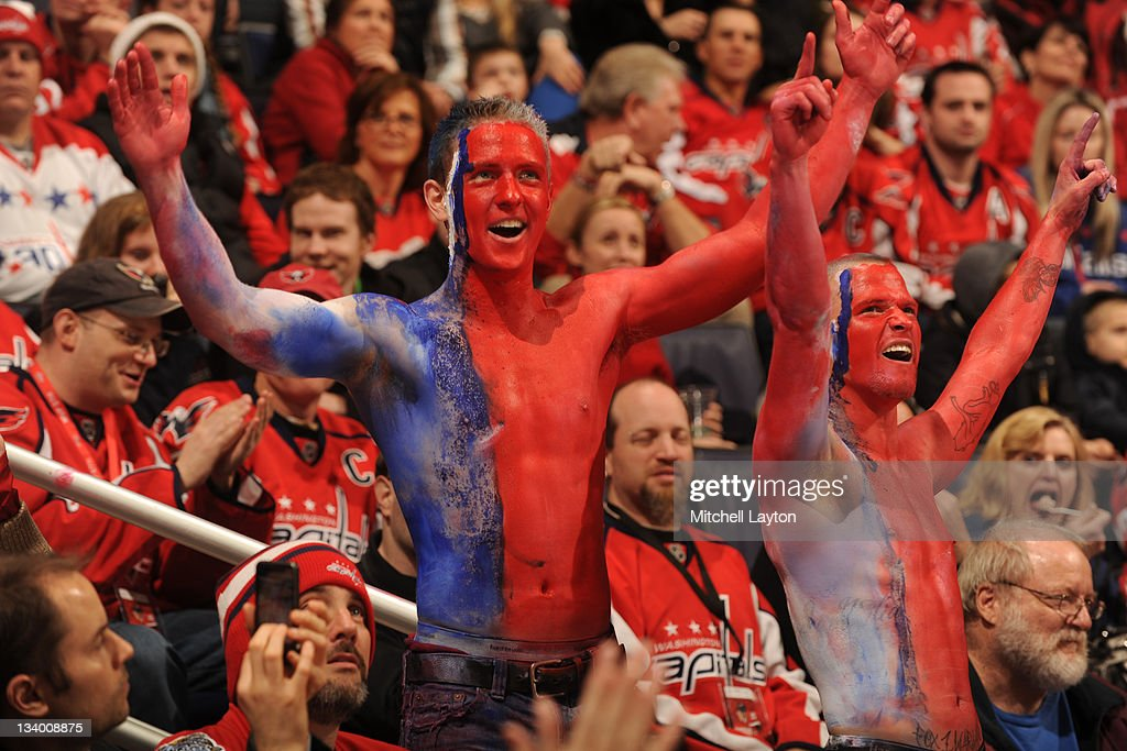 Fans of the Washington Capitals cheer during a NHL hockey game against the Winnipeg Jets on November 23, 2011 at the Verizon Center in Washington, DC.