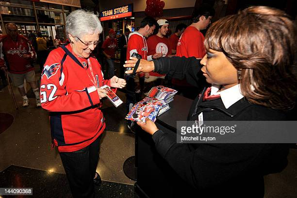Fans of the Washington Capitals get their tickets scanned before Game Six of the Eastern Conference Semifinals against the New York Rangers during...