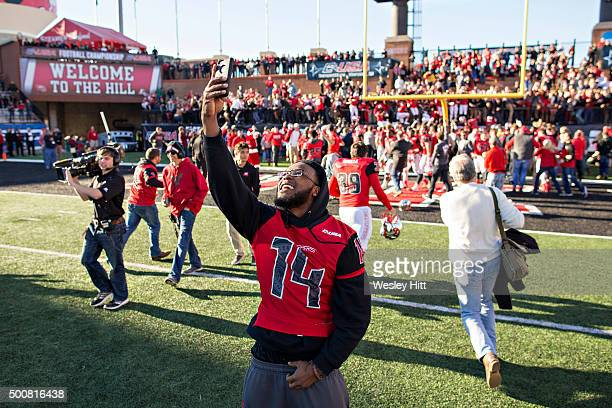 Fans of the WKU Hilltoppers run onto the field to celebrate after a game against the Southern Miss Golden Eagle at HouchensSmith Stadium on December...
