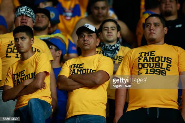 Fans of Tigres look dejected after the Final second leg match between Pachuca and Tigres UANL as part of the CONCACAF Champions League 2016/17 at...
