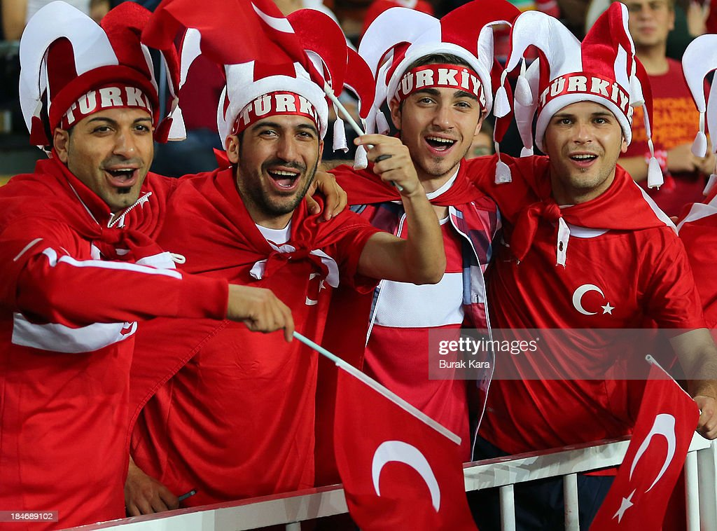 Fans of Turkey show their colours during FIFA 2014 World Cup Qualifier match at the Sukru Saracoglu Stadium on October 15, 2013 in Istanbul, Turkey.