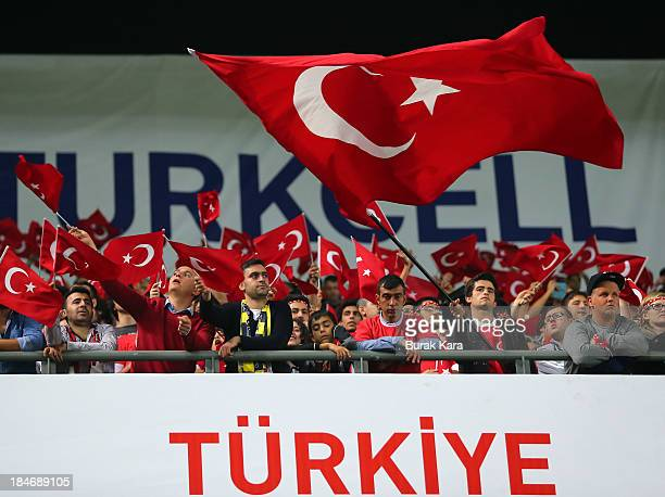 Fans of Turkey wave the Turkish flag during FIFA 2014 World Cup Qualifier match at the Sukru Saracoglu Stadium on October 15 2013 in Istanbul Turkey