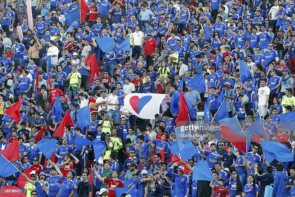 Fans of U de Chile support during a match between O'Higgins and U de Chile as part of the Torneo Apertura at National Stadium, on October 05, 2013 in Santiago, Chile.