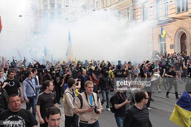 Fans of Ukrainian Football Club Metalist and Football Club Dnipro gather during a march to support a united Ukraine on April 27 2014 in Kharkiv...