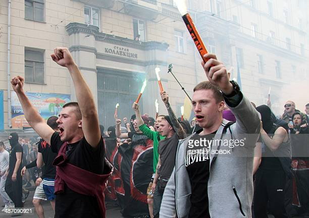 Fans of Ukrainian Football Club Metalist and Football Club Dnipro in normal times implacable enemies gather during a march to support a united...