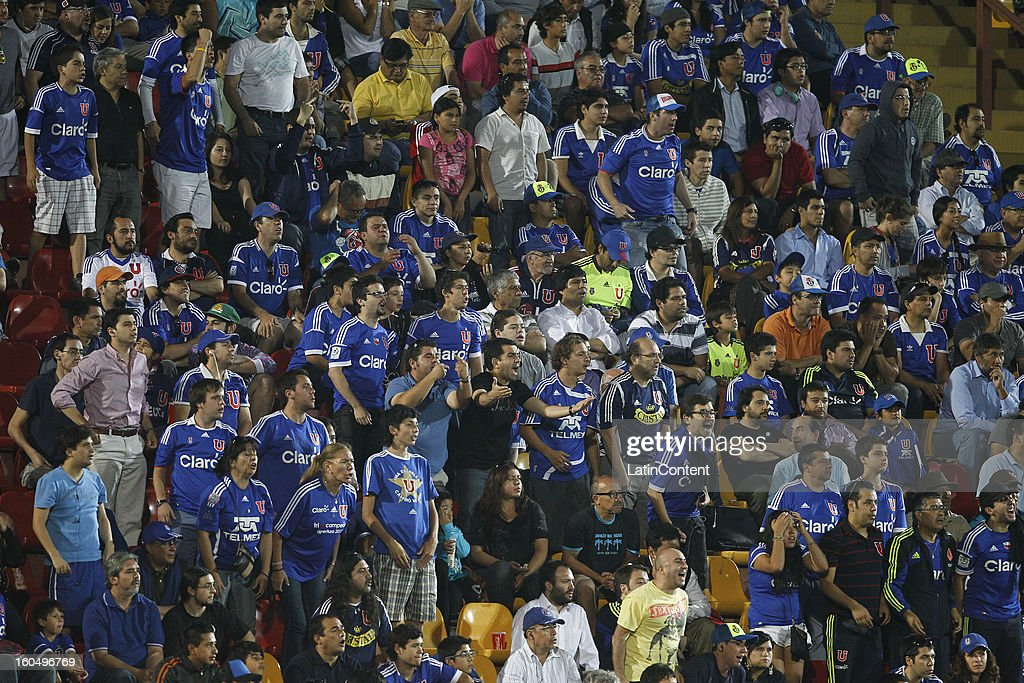 Fans of Universidad de Chile cheer their team during a match between Universidad de Chile and Audax Italiano as part of the Torneo Transición 2013 at Santa Laura Stadium on February 01, 2013 in Santiago, Chile.