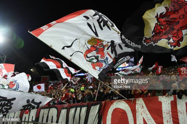 Fans of Urawa Red Diamonds celebrates their 61 win after the AFC Champions League Group F match between Urawa Red Diamonds and Western Sydney at...